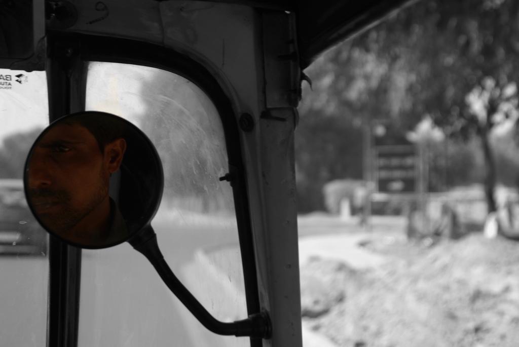Chauffeur de rickshaw, Inde