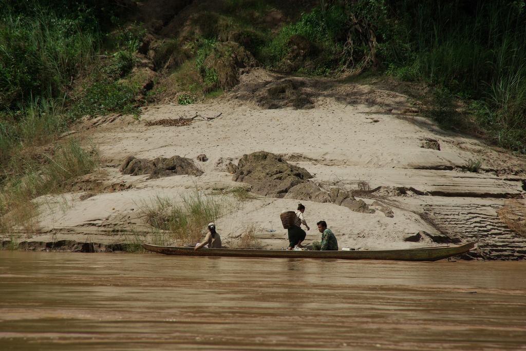 Scène de vie sur le Mékong, Laos