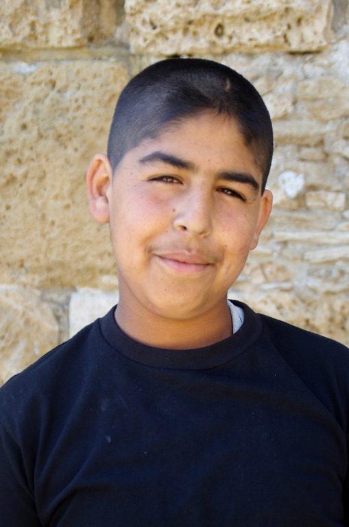 Jeune syrien devenu cireur de chaussures